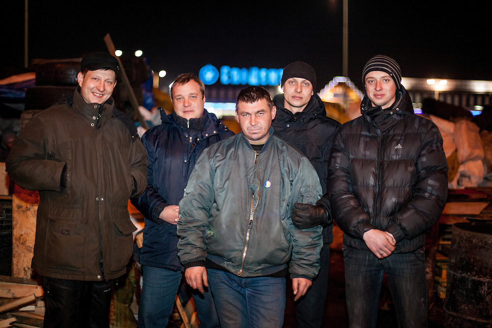 """The core group of activists from left Oleg, Dimi, """"Bosch"""", Andrej and his brother in front of the Barrikades blocking a building supplies store named """"Epicenter"""" in the city of Lviv, Ukraine."""