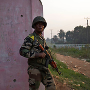 December 20th 2013, a FOMAC soldier hides as sporadic shooting takes place inside the alleys of Bangui.