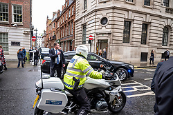© Licensed to London News Pictures. 30/01/2020. London, UK. US Secretary of State Mike Pompeo leaves through the back door of the Institution of Mechanical Engineers in Westminster in a large motorcade, surround by security, as he heads to Downing Street for a meeting with Prime Minister, Boris Johnson. Photo credit: Alex Lentati/LNP