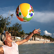 Asian tourists playing a ball game in the pristine waters of White Beach, Boracay Island, the Philippines on October 1, 2008, Photo Tim Clayton..Asian tourists at White Beach, Boracay Island, the Philippines...The 4 km stretch of White beach on Boracay Island, the Philippines has been honoured as the best leisure destination in Asia beating popular destinations such as Bali in Indonesia and Sanya in China in a recent survey conducted by an International Travel Magazine with 2.2 million viewers taking part in the online poll...Last year, close to 600,000 visitors visited Boracay with South Korea providing 128,909 visitors followed by Japan, 35,294, USA, 13,362 and China 12,720...A popular destination for South Korean divers and honeymooners, Boracay is now attracting crowds of tourists from mainland China who are arriving in ever increasing numbers. In Asia, China has already overtaken Japan to become the largest source of outland travelers...Boracay's main attraction is 4 km of pristine powder fine white sand and the crystal clear azure water making it a popular destination for Scuba diving with nearly 20 dive centers along White beach. The stretch of shady palm trees separate the beach from the line of hotels, restaurants, bars and cafes. It's pulsating nightlife with the friendly locals make it increasingly popular with the asian tourists...The Boracay sailing boats provide endless tourist entertainment, particularly during the amazing sunsets when the silhouetted sails provide picture postcard scenes along the shoreline...Boracay Island is situated an hours flight from Manila and it's close proximity to South Korea, China, Taiwan and Japan means it is a growing destination for Asian tourists... By 2010, the island of Boracay expects to have 1,000,000 visitors.