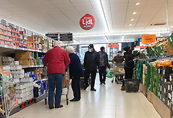 © Licensed to London News Pictures. 15/01/2021. London, UK. Shoppers wearing protective face coverings in Lidl supermarket in north London. Lidl is named the cheapest supermarket of 2020, according to Which? The consumer group tracked 45 own-label and branded products in eight major supermarkets for at least 100 days between January and December 2020 and Lidl was the cheapest supermarket in the study, with the basket costing £42.67 on average. Photo credit: Dinendra Haria/LNP