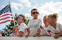 Cool shades on board the Boys and Girls Club float for the 4th of July parade making their way down North Main Street towards Opechee Thursday afternoon.  (Karen Bobotas/for the Laconia Daily Sun)