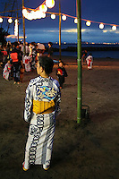 """Yukata is a Japanese summer robe. People wearing yukata are a common sight at fireworks displays, bon odori festivals and other summer events. The yukata is a casual form of kimono that is also frequently worn after bathing at traditional Japanese inns. Though their use is not limited to after bath wear, yukata literally means """"bath clothes"""". Like other forms of clothing based on traditional Japanese garments, it is made with straight seams and wide sleeves. Unlike formal kimono, yukata are typically made of cotton rather than silk. Traditionally yukata were mostly made of indigo-dyed cotton but today a wide variety of colors and designs are available. Like the more formal kimono, the general rule is the younger the person, the brighter the color and bolder the pattern."""