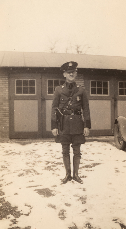 A young officer showing of his new uniform