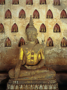 LAOS, VIENTIANE, BUDDHISM, Wat Si Saket,Buddha statue & niches with small statues