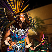 080714      Cayla Nimmo<br /> <br /> The Aztec dancers closed the parade, dancing along Coal Street in front of Sammy C's Thursday night for the annual Intertribal Ceremonial night parade.