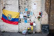 Memorial to a Columbian man who was killed following a street fight on this spot on Southwark Street. December 2010. Cards, pictures and messages from friends adorn the wall.