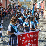 During the morning on the day before Guatemalan Independence Day (which is celebrated on September 15), hundreds of school children from Antigua and the surrounding villages march in a parade of school groups in Antigua, some in costumes and others in their school uniforms. The parade includes school marching bands and cheerleaders as well. The procession starts at Parque Central and weaves its way past the bright yellow La Merced church and onto the municipal stadium.