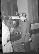 Peter Hughes in Guard Uniform.   B269..1960..06.01.1960..01.06.1960..6th January 1960..Pictured strolling through Dublin was Mr Peter Hughes resplendent in his Guards Uniform...Image taken in the General Post Office (G.P.O.), Dublin as Peter takes the time to buy some stamps.