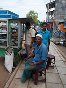 Sri Lanka, Ampara District, Arugam Bay, Pottuvil a small fishing village and popular surfing resort. A shop in the main street of Pottovil. This community was damaged during the 2004 Tsunami