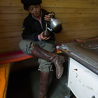 A young gaucho drinks traditional mate (tea) in Torres del Paine National Park, Chile.