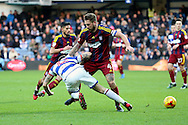 Queens Park Rangers striker Jamie Mackie (12) getting tackled by Ipswich Town defender Luke Chambers (4) during the EFL Sky Bet Championship match between Queens Park Rangers and Ipswich Town at the Loftus Road Stadium, London, England on 2 January 2017. Photo by Matthew Redman.