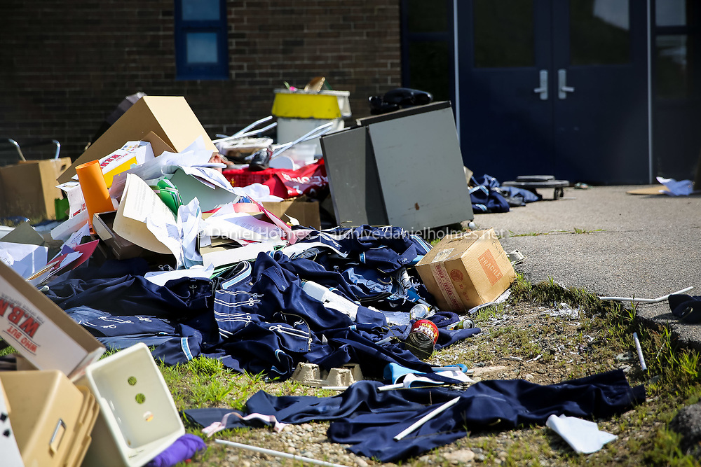 (8/4/14, FRANKLIN, MA) Discarded band uniforms outside the old Franklin High School on Monday. Daily News and Wicked Local Photo/Dan Holmes