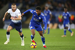 Leicester City's Demarai Gray (right) and Tottenham Hotspur's Eric Dier battle for the ball during the Premier League match at the King Power Stadium, Leicester.