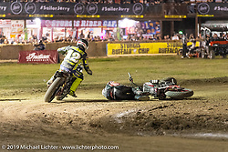 AMA flattracker (no. 12) Jay Maloney on his Indian FTR750 racer races around downed fellow FTR rider (no. 14) Briar Bauman in the AMA Flat track racing at the Sturgis Buffalo Chip during the Sturgis Black Hills Motorcycle Rally. Sturgis, SD, USA. Sunday, August 4, 2019. Photography ©2019 Michael Lichter.