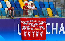 Liverpool fans hang a banner in the stands ahead of the UEFA Champions League Final at the NSK Olimpiyskiy Stadium, Kiev.