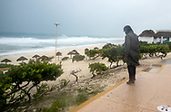 A officer stands guard to prevent people from approaching the beaches during the tropical storm Gamma that made landfall in Tulum, which caused several damages due to continuous rains and floods in different parts of Quintana Roo. Red Alert was declared in several Municipalities of the Mexican Caribbean, so authorities enabled shelters for people in vulnerable situations. (Photo by Rodolfo Flores/Speed Media)