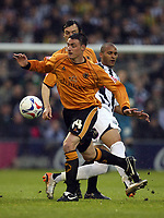 Photo: Rich Eaton.<br /> <br /> West Bromwich Albion v Wolverhampton Wanderers. Coca Cola Championship. Play off Semi Final 2nd Leg. 16/05/2007. Wolves Darren Potter (left) gets to the ball ahead of Diomansy Kamara