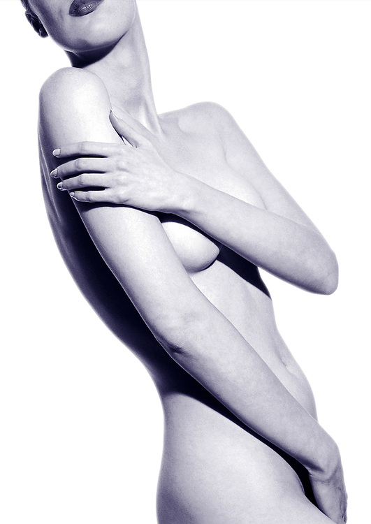Toned photo of nude woman's flawless body with hand caressing arm and other hand covering her crotch