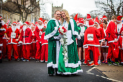 © Licensed to London News Pictures. 25/11/2018. Skipton UK. Wendy Lawson & Alex Griffin got married today during the Skipton Santa run, the couple ran the first half of the race then stopped at Skipton register office to get married, they then went on to complete the race. Over 1800 runners dressed as Santa are taking part in the Great Skipton Santa fun run today in the Yorkshire town of Skipton. The Annual event see's people dressed as father Christmas running a 5km route through the streets of Skipton in support of local charities. Photo credit: Andrew McCaren/LNP