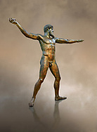 Early classical ancient Greek bronze statue of Zeus or Poseidon, circa 450 BC. Athens National Arcjaeological Museum, cat no X15161<br /> <br /> This bronze statue was found in the sea off Cape Artemision in northern Euobea. Zeus or Poseidon is shown making a great stride. His lefy arm is extended forward and his righy arm extends back which would have held a thunderbolt, if Zeus, or a trident if Poseidon. The identification of the statue is controversial though it ios more likely Zeus. <br /> <br /> It is one of the few preserved original statues of Severe Style, notable for the exuisite rendering of motion and anatomy. Iy is certainly the work of a great sculptor of the early ancient Greek Classical period .<br /> <br /> If you prefer to buy from our ALAMY STOCK LIBRARY page at https://www.alamy.com/portfolio/paul-williams-funkystock/greco-roman-sculptures.html . Type -    Athens    - into LOWER SEARCH WITHIN GALLERY box - Refine search by adding a subject, place, background colour, etc.<br /> <br /> Visit our ROMAN WORLD PHOTO COLLECTIONS for more photos to download or buy as wall art prints https://funkystock.photoshelter.com/gallery-collection/The-Romans-Art-Artefacts-Antiquities-Historic-Sites-Pictures-Images/C0000r2uLJJo9_s0