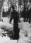 Russian Revolution: Emperor Nicholas II shovelling snow in the grounds of Tsarskoe Selo, Russia where he was imprisoned with the royal family in 1917. USSR  Deposition Winter