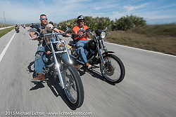 """""""Moonshiner Josh"""" Owens with his dog """"Cutie Pie"""" riding his 2005 Harley-Davidson Softail alongside Ron Linville on A1A south of Flagler Beach during Daytona Beach Bike Week 2015. FL, USA. March 13, 2015.  Photography ©2015 Michael Lichter."""