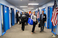 BENTONVILLE, AR - JULY 7:  Small product manufactures in the hallway outside of presentation rooms before and after their presentations at the Walmart Head Quarters in Bentonville, Arkansas.<br /> Wesley Hitt for the Wall Street Journal