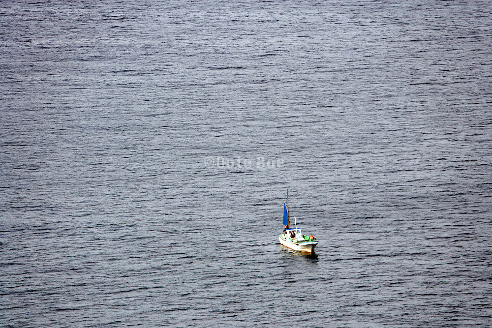 one little boat on a large water