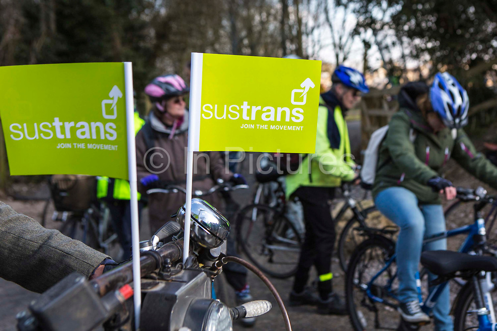 Two green Sustrans flags displayed on a bicycle handlebars at the opening of the Bath Two Tunnels Greenway on 6th April 2013 in Somerset, United Kingdom.  A large number of cyclists and pedestrians attended the event to celebrate the restored railway tunnels which link 13-miles through the beautiful country-side.  The restoration of the tunnels was organised by Sustrans, working in partnership with Bath and North East Somerset Council.   Sustrans is a charity that works with communities, policy-makers and partner organisations so that people can choose healthier, cleaner and cheaper journeys and enjoy better, safer spaces to live in. The event was attended by hundreds of people.