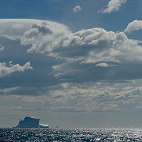 Wind-generated lenticular clouds hover over icebergs in the southern Atlantic Ocean near South Georgia, Antarctica.