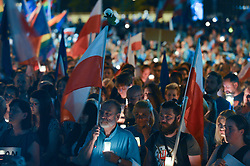 July 24, 2017 - Krakow, Poland - An anti-government candle-lit vigil in front of Krakow's District Court on Monday evening where hundreds gathered for the eighth consecutive night demanding that the Polish President veto the third proposal in relation to judical reform..On Monday, July 24, 2017, in Krakow, Poland. (Credit Image: © Artur Widak/NurPhoto via ZUMA Press)