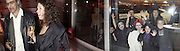 Jennifer Smit and Halloween children looking through window. Unseen Vogue. Design Museum. 312 October 2002. © Copyright Photograph by Dafydd Jones 66 Stockwell Park Rd. London SW9 0DA Tel 020 7733 0108 www.dafjones.com