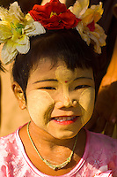 Young Burmese girl with thanaka bark sunscreen on her face, near the Hai Lo Min Lo Temple, Bagan, Myanmar (Burma)
