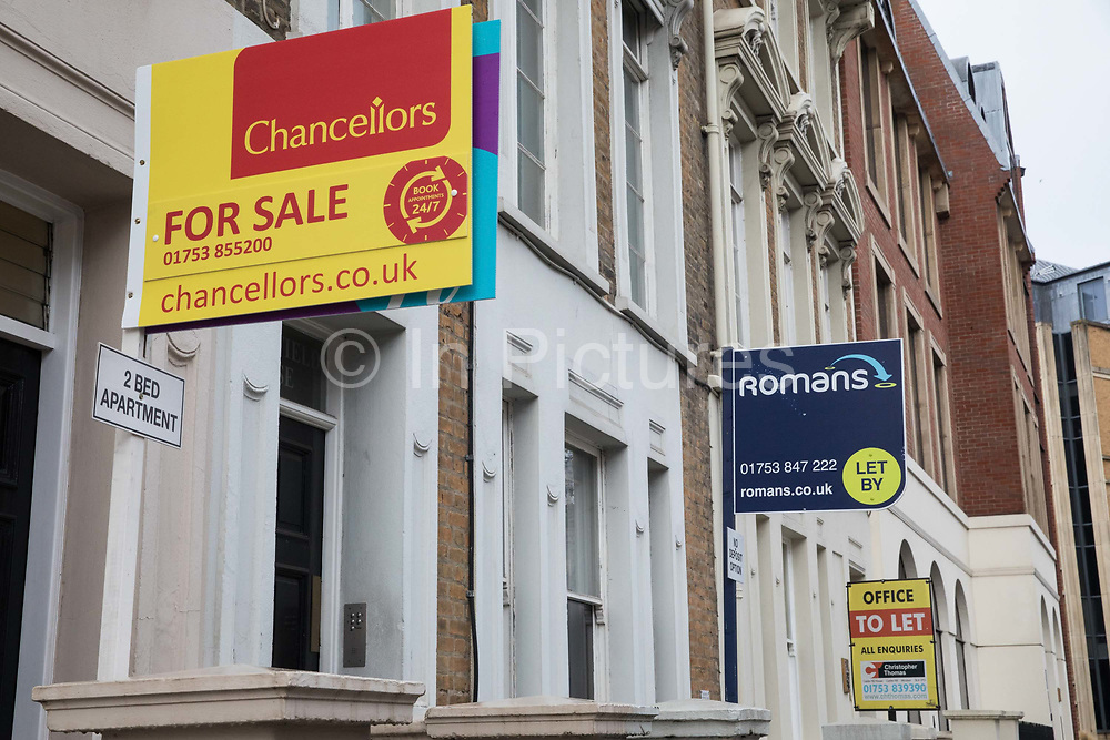 Estate agent boards advertising properties for sale and to let are pictured during the second coronavirus lockdown on 9th November 2020 in Windsor, United Kingdom. The Housing Secretary Robert Jenrick has advised that the property market may continue to operate during the lockdown provided that safety guidance intended to prevent the spread of COVID-19 is followed.