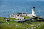 1909 Neist Point Lighthouse, on Isle of Skye, Scotland, United Kingdom, Europe. An aerial cableway takes supplies to the lighthouse and cottages. Since 1990, the lighthouse has been operated remotely from the Northern Lighthouse Board headquarters in Edinburgh. The former keepers' cottages are now in private ownership.
