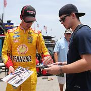 Driver Joey Logano signs autographs during the Nationwide practice session at Daytona International Speedway on Thursday, July 3, 2014 in Daytona Beach, Florida.  (AP Photo/Alex Menendez)