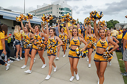 Sep 22, 2018; Morgantown, WV, USA; West Virginia Mountaineers cheerleaders lead the team into the stadium before their game against the Kansas State Wildcats at Mountaineer Field at Milan Puskar Stadium. Mandatory Credit: Ben Queen-USA TODAY Sports