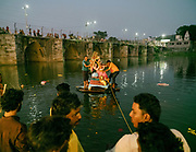 Immersing deity in a holy river. People celebrating Dussehra in Chittorgarh. Dussehra is a Hindu celebration and signifies the day of the victory of truth and justice when Lord Rama was successful in killing the demon king Ravana in the famous Indian epic of Ramayana.