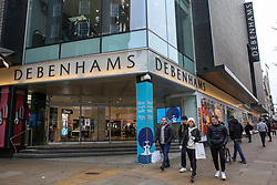 © Licensed to London News Pictures. 10/01/2019. London, UK. Department store chain Debenhams reports a 5.7% fall in like-for-like sales in the 18 weeks to 5 January 2019. Shoppers walk past the Debenhams store on Oxford Street. Photo credit: Dinendra Haria/LNP