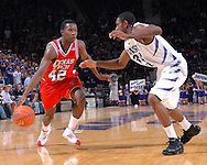 Texas Tech guard Charlie Burgess (42) drives against pressure from Kansas State's Akeem Wright (34) during the first half at Bramlage Coliseum in Manhattan, Kansas, January 8, 2007.  Texas Tech defeated K-State 62-52.