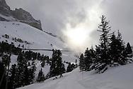 Sun and clouds above the toboggan run from Kleiner Scheidegg to Grindelwald - Swiss Alps - Switzerland