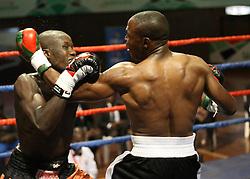 Daniel Wanyonyi of Kenya punch Baraka Mwakasopa of Tanzania to win the Super Middle weight on a TKO during their Mac Series Professional Boxing Bonaza at Safaricom Indoor Arena in Nairobi on November 5, 2016. Wanyonyi won on a TKO. Photo/Fredrick Onyango/www.pic-centre.com (KEN)
