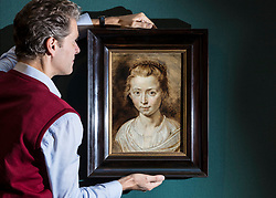 A beautiful and intimate family portrait by one of the greatest of all seventeenth-century artists will be on display at the Scottish National Gallery in Edinburgh between 17 November 2017 and 28 January 2018. Portrait of the Artist's Daughter, Clara Serena by Sir Peter Paul Rubens (1577-1640) was probably painted about 1623, not long before the sitter's tragically early death at the age of 12. This charming painting, which, after cleaning, has only recently been unanimously accepted as being by Rubens, has never before been shown in the UK.<br /> <br /> Pictured: Tico Seifert, Senior Curator for Northern European Art at the Gallery with Portrait of the Artists Daughter, Clara Serena