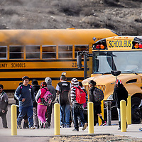 010914       Cable Hoover<br /> <br /> Gallup Middle School students head for the busses after class Thursday.