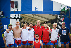 © Licensed to London News Pictures. 04/07/2018. Henley-on-Thames, UK. Rowers from Wallingford Rowing Club pose for a post race photograph while wearing England Football team shirts on day one of the Henley Royal Regatta, set on the River Thames by the town of Henley-on-Thames in England. Established in 1839, the five day international rowing event, raced over a course of 2,112 meters (1 mile 550 yards), is considered an important part of the English social season. Photo credit: Ben Cawthra/LNP