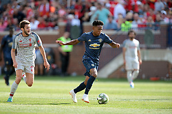 July 28, 2018 - Ann Arbor, Michigan, United States - Demitri Mitchell (35) of Manchester United under the pressure of Adam Lallana (20) of Liverpool during an International Champions Cup match between Manchester United and Liverpool at Michigan Stadium in Ann Arbor, Michigan USA, on Wednesday, July 28,  2018. (Credit Image: © Amy Lemus/NurPhoto via ZUMA Press)