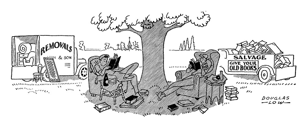 (Removal and old books salvage men sit under a tree reading books seated in comfortable arm chairs)
