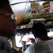 A street in a Jeepney. Jeepneys are the most popular means of public transport in the Philippines. They were originally made from US military jeeps left over from World War 2 and are well know for their flamboyant decoration and crowded seating. They are a symbol of Philippine culture. on October 8, 2008 at Divasoria markets, Manila, the Philippines. Photo Tim Clayton