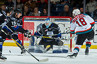 KELOWNA, CANADA - DECEMBER 30: Griffen Outhouse #30 of the Victoria Royals makes a save against a shot by Carsen Twarynski #18 of the Kelowna Rockets on December 30, 2017 at Prospera Place in Kelowna, British Columbia, Canada.  (Photo by Marissa Baecker/Shoot the Breeze)  *** Local Caption ***